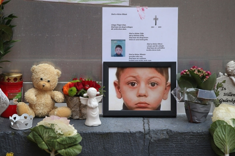 A makeshift memorial for four-year-old Mohamed Januzi near Berlin's Central Registration Office for Asylum Seekers in 2015. The child was abducted and murdered by a German [Sean Gallup/Getty Images]