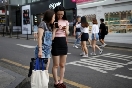 Church leaders and experts point to unemployment, the hierarchical nature of organised religion and smartphones as reasons for a waning interest in religion. Hongdae, Seoul [Kim Hong-Ji/Reuters]