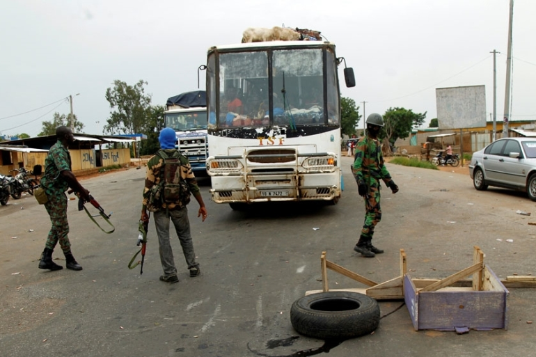 Mutineers sealed off the city of Bouake and blocked the main border crossing to Burkina Faso [Luc Gnago/Reuters]