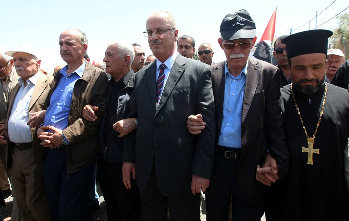 Palestinian Prime Minister Rami Hamdallah joined one of the Nakba Day rallies. [Alaa Badarneh/EPA]