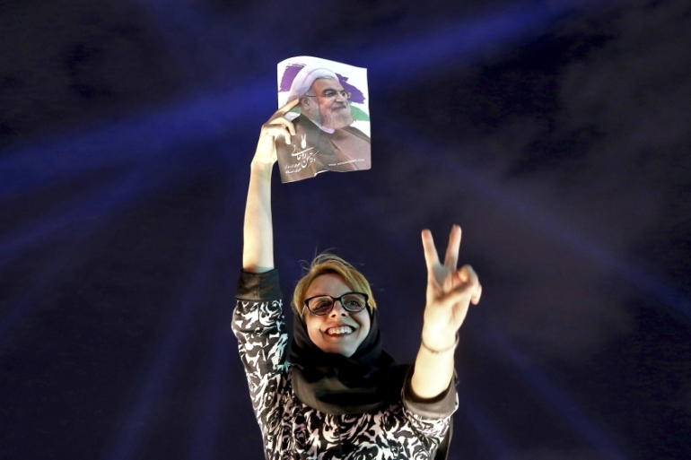 A supporter of Hassan Rouhani flashes a victory sign while celebrating his victory in the presidential election, in Tehran, Iran [AP]