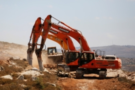 Heavy machinery at work in a field as construction of Amichai, the first Israeli settlement in two decades, begins [Reuters]