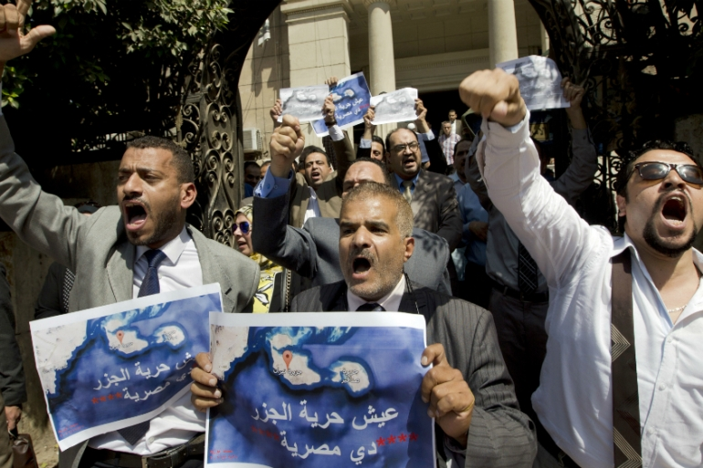 Protesters denounce the accord to hand over control of two strategic Red Sea islands to Saudi Arabia [Amr Nabil/AP]