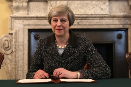 British Prime Minister Theresa May in the cabinet office signs the official letter invoking Article 50 and the United Kingdom's intention to leave the EU [Christopher Furlong/Getty Images]