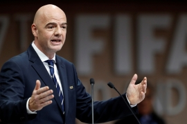 Gianni Infantino says FIFA's role was to deal with football and not to interfere in geopolitics [Hamad Mohammed/Reuters]