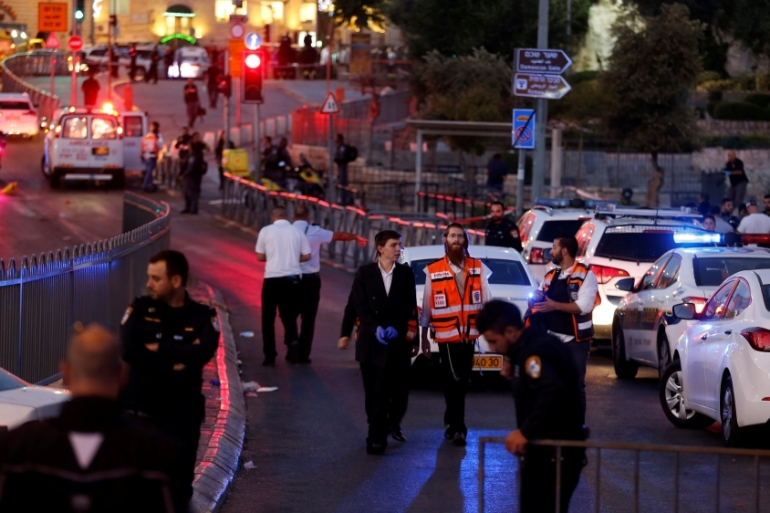 Israeli policemen secure the scene of the attack outside Damascus Gate in Jerusalem's Old City [Ammar Awad/Reuters]