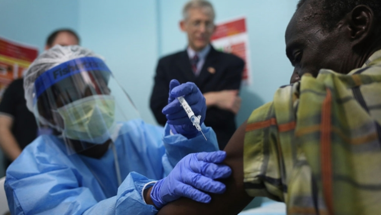 In a photo from 2015, a nurse administers an injection on the first day of the Ebola vaccine study being conducted at Redemption Hospital in Monrovia, Liberia [File: Getty Images]
