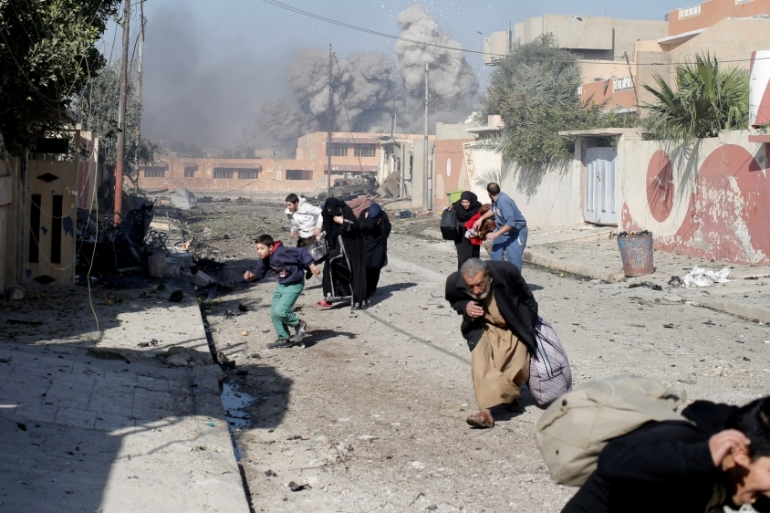 Civilians run in panic after coalition aerial bombardment hit ISIL positions in Mosul, Iraq [Reuters]
