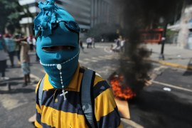 Anti-government protester in Caracas, Venezuela. More than 70 people have been killed during almost 90 days of protests seeking President Nicolas Maduro's removal. [Fernando Llano/AP Photo]