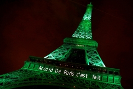"The Eiffel tower is illuminated in green with the words ""Paris Agreement is Done"", to celebrate the Paris UN COP21 Climate Change agreement in November 2016. [Jacky Naegelen/Reuters]"