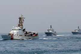 Military ships are seen during a naval exercise by US and Qatari troops in the Gulf on June 16 [Reuters /Naseem Zeitoon]
