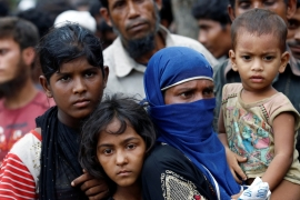 Rohingya refugees gather to collect relief supplies at the Balukhali Makeshift Refugee Camp in Bangladesh May 31, 2017 [Mohammad Ponir Hossain/Reuters]