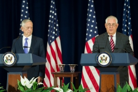 Rex Tillerson, right, and Jim Mattis appear at news conference following talks on Wednesday [Cliff Owen/AP]
