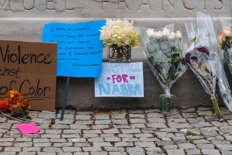 A memorial in downtown Washington, DC, set up for Nabra Hassanen, the 17-year-old girl murdered on Sunday [Creede Newton/Al Jazeera]