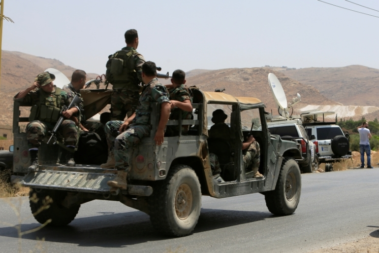 Lebanese army soldiers patrol the entrance of the border town of Arsal, in the Bekaa Valley [Reuters]