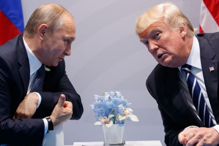 US President Donald Trump meets with Russian President Vladimir Putin. US officials believe Russia may attempt to interfere in the US 2020 election as it did in 2016 in Trump's favour [File: Evan Vucci/AP Photo]