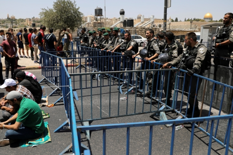 Men under the age of 50 have been banned from entering al-Aqsa Mosque compound [Ammar Awad/Reuters]