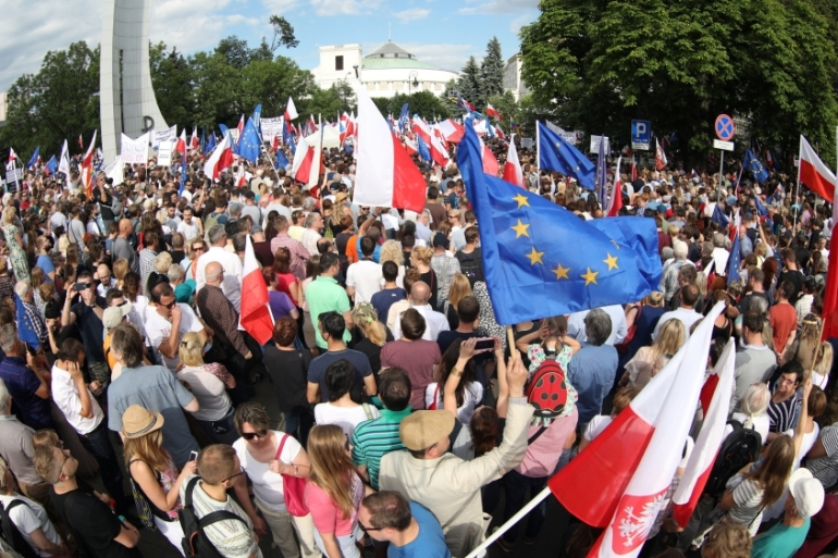 Protesters gather in front of the Parliament building during an opposition protest in Warsaw, Poland, July 16, 2017 [Reuters]