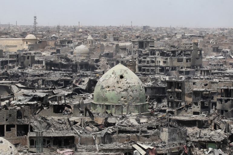 According to government sources, the damages incurred in the fight against ISIL has left 80 percent of the city in ruins [File: AFP]