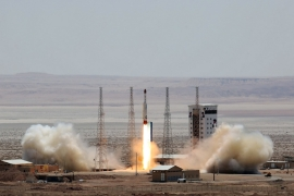 Iran launched its Simorgh satellite rocket at an undisclosed location in Iran on Thursday. [Handout/Iranian Defence Ministry/AFP]