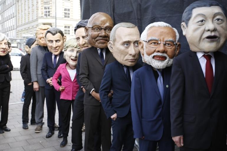 Protesters dressed as the G20 leaders during a demonstration against the forthcoming G20 economic summit in Hamburg [Morris MacMatzen/Getty Images]