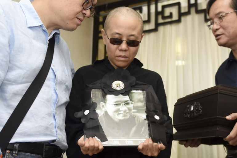 Liu Xia was last seen in an official photo taken on July 15 at her husband's funeral [Handout/AP]