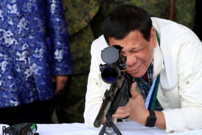 Duterte's war on drugs, which resulted in thousands of killings, has earned condemnation from various human rights advocates [Romeo Ranoco/Reuters]