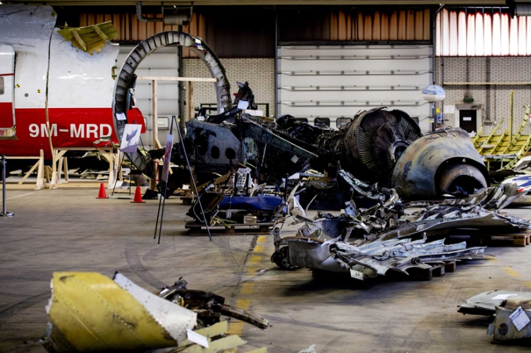MH17 debris is on display at Gilze-Rijen Air Base in The Netherlands [Robin Van Lonkhuijsen/EPA]