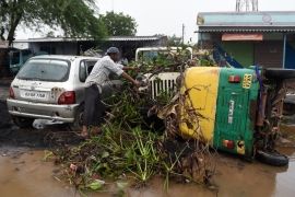 Damaged vehicles after heavy rains in Morbi district in northern Gujarat, India [Sam Panthaky/AFP]