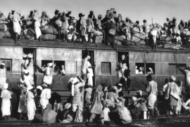 Muslim sit on top of a train near New Delhi in September 1947. Millions of Muslims migrated from India to Pakistan after partition as millions of Hindus and Sikhs migrated in the other direction [AP]