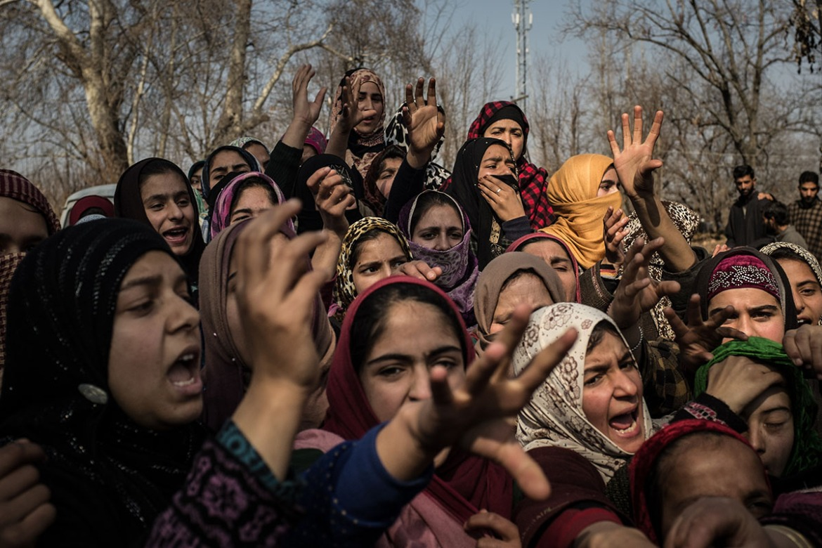 Kashmiri girls shout slogans decrying both the killing of her 60-year-old neighbour, killed in a shootout between fighters and Indian soldiers. 'Azadi, Azadi' - Freedom', she chants. 'There is only one solution: Gun solution! Gun solution! There is only one track: go India, go back!' The night before Kashmiri fighters had ambushed a convoy of Indian soldiers. Three Indian soldiers were also killed in the shoot-out. [Violeta Santos Moura/Al Jazeera]