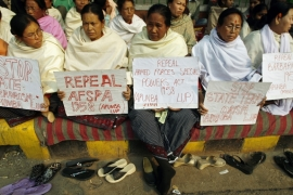 Women from the northeastern Indian state of Manipur protesting against the AFSPA, which gives troops the right to arrest and shoot at suspected rebels [Adnan Abidi/Reuters]