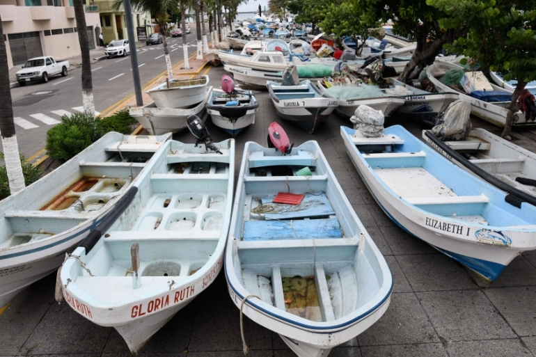 Fishing boats are kept on a street in the port city of Veracruz to protect them from winds and waves brought by Hurricane Franklin [Victoria Razo/AFP]