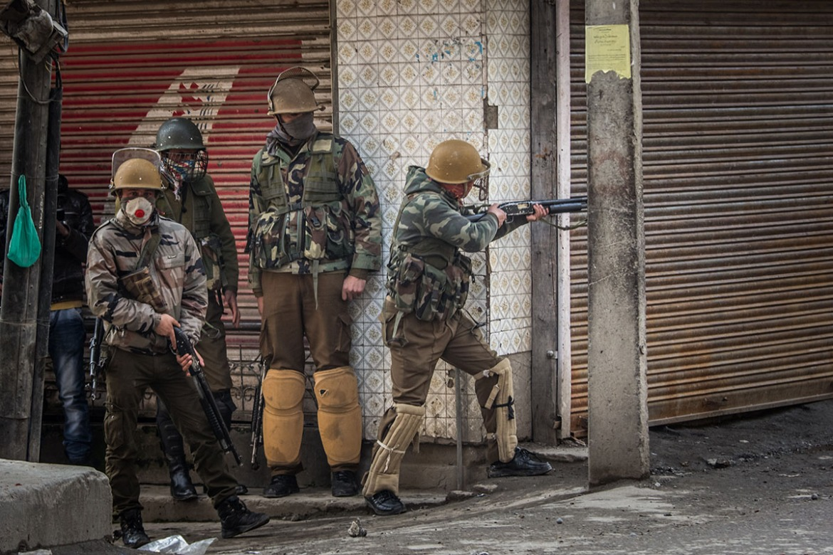 Indian forces fire with a pellet rifle at protesting Kashmiri youths, after Friday prayers in the old part of Srinagar. Over 7,000 people received pellet related injuries during mass protests in the summer of 2016, according to some reports, of whom 1,200 people were blinded as a result of pellet injuries. [Violeta Santos Moura/Al Jazeera]