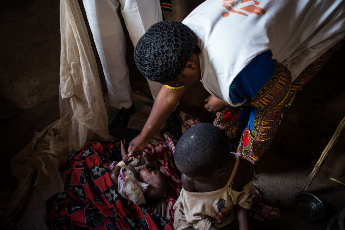 An MSF worker tends to a new born baby at Circle Filtsaf primary school in Kalemie. The mortality rate for children under the age of five is the same as that expected during the acute phase of an emergency. [Lena Mucha/Al Jazeera]