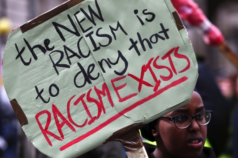 A protester takes part in a demonstration against racism in London on March 18, 2017 [Neil Hall/Reuters]