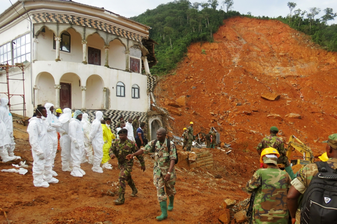 Over 400 people were killed and more than 2,000 were left homeless by the mudslides, leaving morgues overflowing and residents desperately searching for loved ones. [Saidu Bah/AFP/Getty Images]