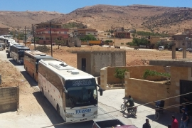 Syrian fighters, refugees leave Jroud Arsal camps