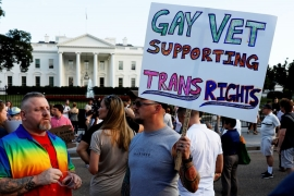 Demonstrators gather to protest US President Donald Trump's announcement that he plans to reinstate a ban on transgender individuals serving in any capacity in the US military [File: Jonathan Ernst/Reuters]