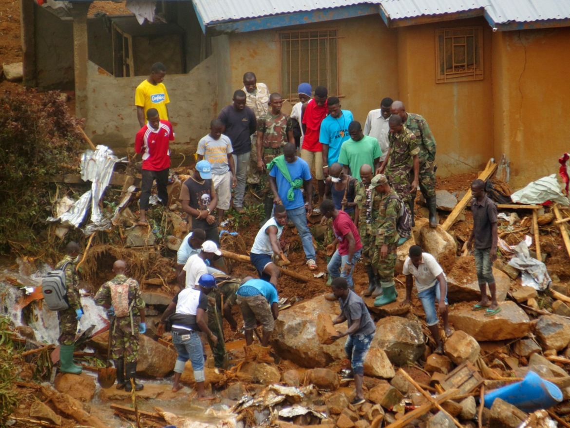 Survivors of the deadly mudslides in Sierra Leone's capital vividly describe the disaster as President Ernest Bai Koroma said the nation is in a 'state of grief'. [Manika Kamara/AP Photo]