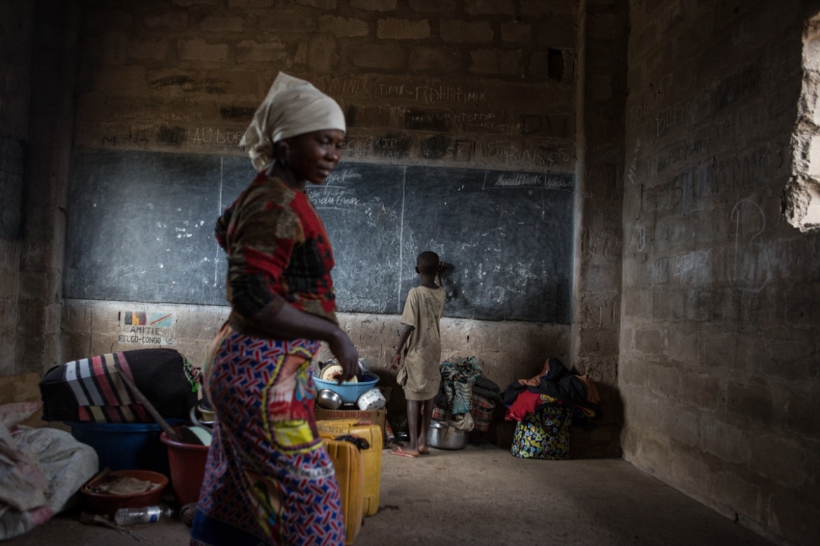 A Bantu woman and child in one of the rooms of the Circle Filtsaf primary school in Kalemie, where they found shelter after escaping the violence in their home village of Tabacongo. They arrived here at the beginning of May and are waiting to be relocated. [Lena Mucha/Al Jazeera]