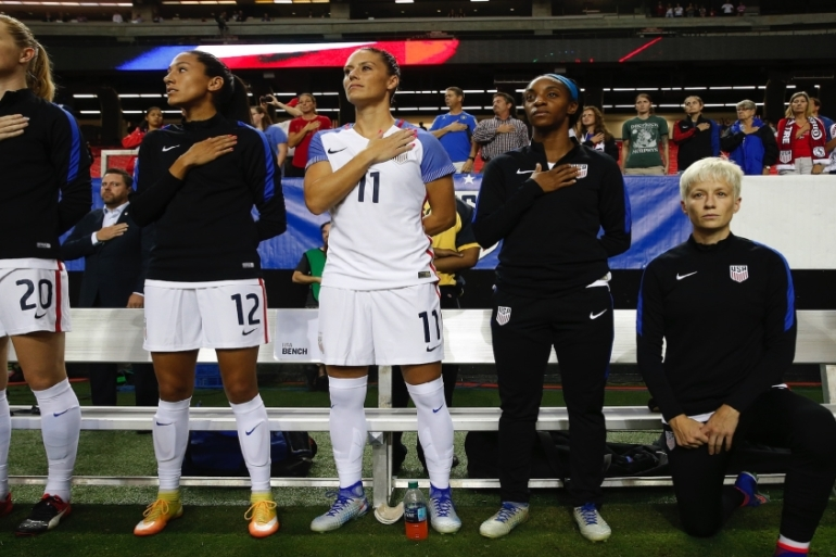 Megan Rapinoe, a member of the women's national team, took a knee during the national anthem to protest because she felt that her liberties as a gay athlete were not protected in the US [AP]