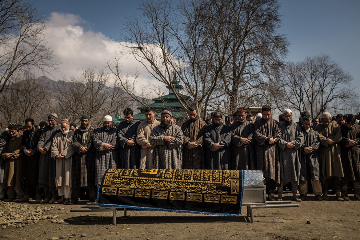 Men pay their respects at a funeral and bury the body of Ghulam Mohi ud Din Rather in the village of Panjpora in Indian-administered Kashmir. The 34-year-old was a soldier of Kashmiri origin who served in the Indian army and was killed, along with two Indian soldiers, in an ambush by Kashmiri fighters on an Indian army convoy in the village of Moul. A civilian was also killed in the shoot-out. Such funerals are rare as there is only a small minority of Kashmiris that join the Indian army whom the Kashmiri population see as occupiers. [Violeta Santos Moura/Al Jazeera]