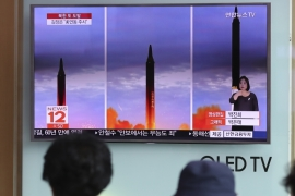 People watch a TV screen showing a local news programme about North Korea's latest missile launch at Seoul Train Station in Seoul, South Korea on Aug 30, 2017 [AP]