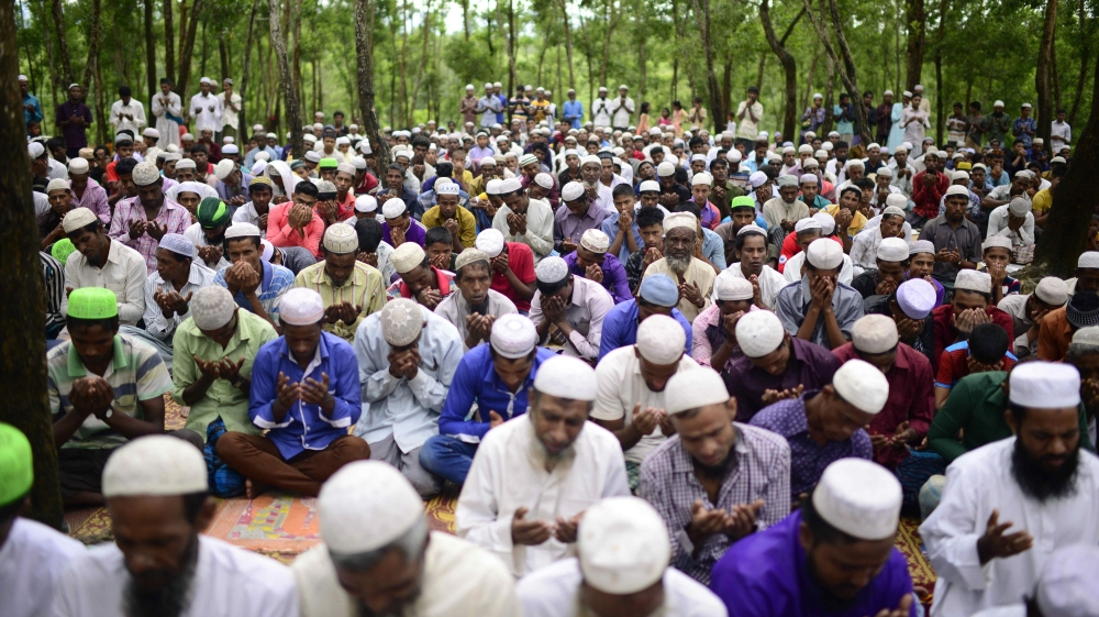 Rohingya refugees offer Eid prayer at a refugee camp near the Bangladesh-Myanmar border [AFP]