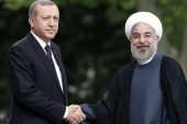 Iran's President Hassan Rouhani and Turkey's President Recep Tayyip Erdogan pose for photographs during a meeting in Ankara in 2014 [Umit Bektas/Reuters]