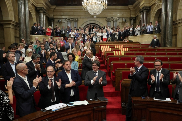 Catalonia's regional parliament voted to push ahead with the referendum [Albert Gea/Reuters]