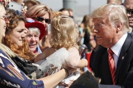US President Donald Trump greets supporters as he arrives in Reno, Nevada on August 23 [AP Photo/Alex Brandon]