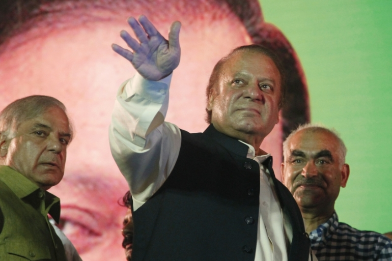 Deposed Pakistani Prime Minister Nawaz Sharif waves to supporters in August 2017 [File: KM Chaudary/AP]