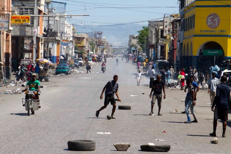 The strike forced many shops and schools to close as employees and students could not get to work or class. [Dieu Nalio/AP Photo]